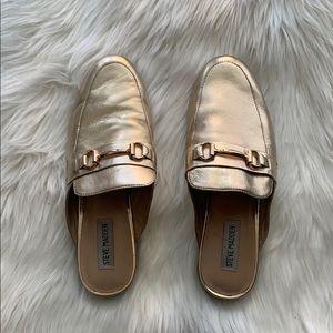 Steve Madden gold backless loafers